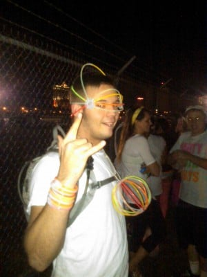 BADER FIELD RAVE: Justin Spare, 19, of Northfield, waits outside at Bader Field for the electronic music event to get underway New Year's Eve.  - JOEL LANDAU