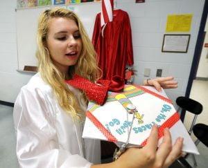 OCHS Graduation: Brooke Hoffner, 18 of Margate check out her cap before the start of Ocean City Graduation Friday, June 20, 2014. - Edward Lea