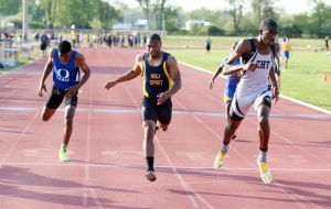Atlantic County Track And Field Championships: Oakcrest's ladarrell Dixon, left third place in 400 mm Holy Spirit's Angelo Dawson, middle second place in and Egg Harbor Township's Alvin Abraham, right first place in 400 mm during Atlantic County track and field championships at Buena Regional High School Thursday, May, 8, 2014. - Edward Lea