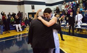 Paul Rodio: SA player 4 Mike Penza hugs Coach Rodio after the game. Monday February 11 2013 St. Augustine Prep boys basketball coach Paul Rodio records his 776th career win Monday to be South Jersey's all-time winningest coach. The game was played against Lower Cape May Regional at St. Augustine. (The Press of Atlantic City / Ben Fogletto)  - Ben Fogletto