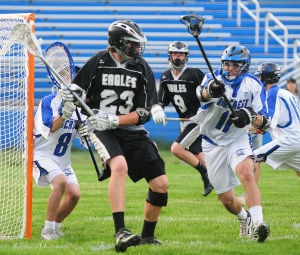 EHT OAKCREST BOYS LACROSSE: EHT's Connor Houghton looks for a shot on the net as Oakcrest's Kyler DeFrancisco applies defensive pressure during their game held at Oakcrest in Mays Landing. Photo/Dave Griffin  - John David Griffin