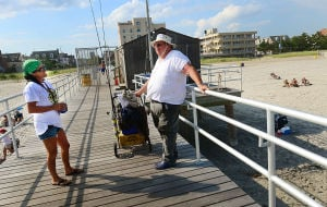 Open Space: Pier manager Patty Curran of Ventnor (left) talks with pier member Dr. Carl Santaniello of Clayton as he finishes a day of fishing. Monday July 29 2013 Ventnor Pier related to open space measure that was up for a vote in the senate on Monday. (The Press of Atlantic City / Ben Fogletto) - Ben Fogletto