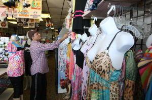 SHOULDER SEASON: Saleem Ahmed of Atlantic City manger of New Fashion T-shirts store on Wildwood Boardwalk Friday, Sept 6, 2013. - Edward Lea