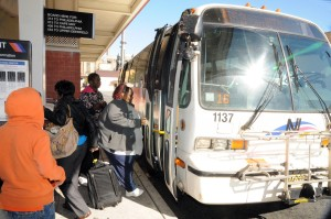 Transportation: Passengers board their bus Thursday at the NJ Transit Bus Terminal on Landis Avenue in Vineland.  - Photo by Dave Griffin