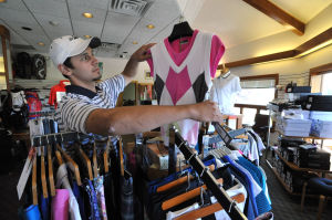 ATS Golf Linwood CC: Assistant Golf Pro Jeff LeFevre, Jr., of Linwood, looks over a clothing display, Friday Sept. 6, 2013, in the Golf Shop at Linwood Country Club. (Staff Photo by Michael Ein/The Press of Atlantic City) - Michael Ein