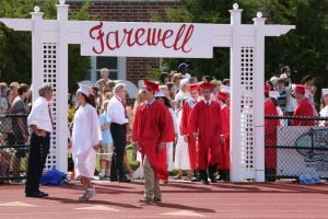 OCHS Graduation: Graduates march into the recreation field for their Graduation Commencement form Ocean City High School Friday, June 20, 2014. - Edward Lea