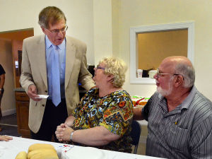 J10 Brigantine Bible Church: 'Pastor Bill' Davis (left) talks with Donna and Bob Cavanaugh of Irmo, S. Carolina, former residents and church members who traveled for the dedication. Sunday June 9 2013 Rededication service and dinner to celebrate reopening of the Brigantine Bible Church, which was heavily damaged by Sandy. The congregation was rebuilding for 6.5 months, and meeting in the Brigantine Community Center for all that time. (The Press of Atlantic City / Ben Fogletto)  - Ben Fogletto