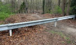 Woods 2:  A new guard rail was installed at the end of Glade Avenue to deter people from entering the woods.   - Dale Gerhard