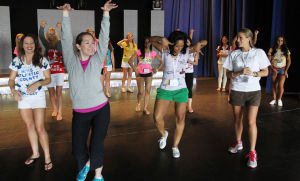 : Choreographer Gabby Kadets of Woodbridge Twp, (middle left) directs contestants during rehearsal at the Music Pier. Miss New Jersey contestants rehearse on stage at the Music Pier. Contestants for this year's Miss New Jersey Pageant in Ocean City Music Pier, arrived in town and began rehearsal for pageant which begins on Thursday. Tuesday June 11, 2013. (Dale Gerhard/The Press of Atlantic City)  - Dale Gerhard