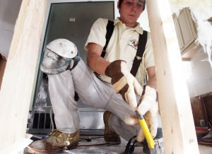 Restoration 3: Kyle Quirk, of Colonial Carpet Cleaning and Restoration, strips drywall and nails from a wall at a home in Sea Isle City.  - Dale Gerhard
