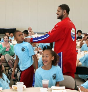 Video:  Franklin jokes around with fourth grade student Dainte Miles during the assembly.  - Photo by Dale Gerhard