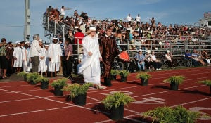 Cumberland Reg Graduation: Graduates enter the athletic field for the graduation ceremony. Monday June 23 2014 Cumberland Regional High School Graduation. (The Press of Atlantic City / Ben Fogletto) - Ben Fogletto