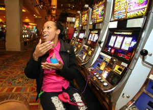 Pennyslots: Justine Harrison of Nashville, N.C., enjoys a penny-slot machine at the Tropicana in Atlantic City on Thursday.  - Edward Lea