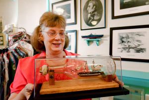 Heritage Tourism: Sally Hastings holds a model of the Intrepid inside a bottle. Friday July 5 2013 The Somers Point Historical Society is looking to create a Heritage Tourism District to highlight the legacy, history and historical landmarks of Somers Point. Sally Hastings of Somers Point is the president of the Somers Point Historical Society, Inc. (The Press of Atlantic City / Ben Fogletto) - Ben Fogletto