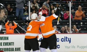 Red Line Classic: Flyers 2 Mark Howe congratulates 29 Todd Fedoruk on a goal. Sunday February 9 2014 Red Line Classic, charity hockey game at Boardwalk Hall in Atlantic City that features NJ firefighters playing with several former Flyers and Devils players. (The Press of Atlantic City / Ben Fogletto) - Photo by Ben Fogletto