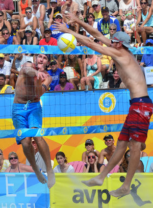 AVP VOLLEYBALL FINALS: Sean Rosenthal (left) gets a shot past the block of Jake Gibb during the men's final. Sunday September 8 2013 AVP beach volleyball tournament in Atlantic City. (The Press of Atlantic City / Ben Fogletto) - Ben Fogletto
