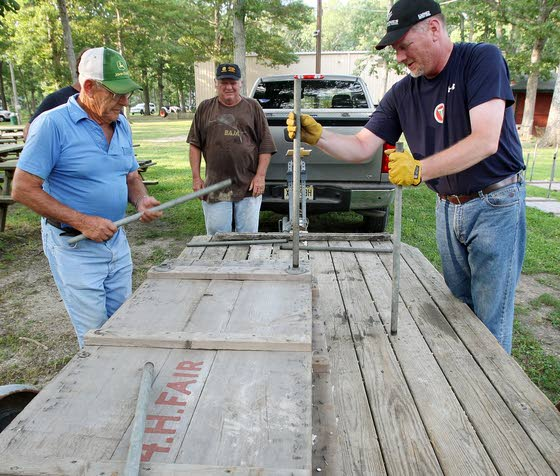 A fair bit of workVolunteers are the backbone of summer's county fairs