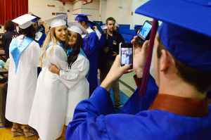 SACRED HEART GRADUATION: Anthony Langdon of Cedarville takes a picture of Abby Bencie of Vineland (left) and Katie O'Rourke of Vineland in the gym before graduation. Monday June 3 2013 Sacred Heart High School Graduation. (The Press of Atlantic City / Ben Fogletto)  - Photo by Ben Fogletto