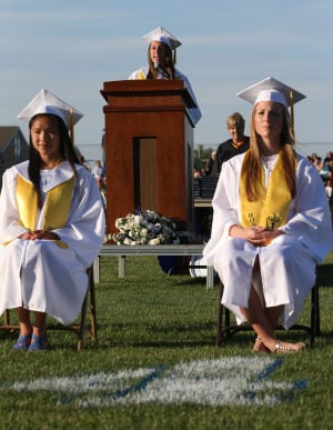 Hammonton High School Graduation: Valedictorian Madalyn DiBona speaks during the Hammonton High School graduation, Friday June 20, 2014, in Hammonton. - Michael Ein