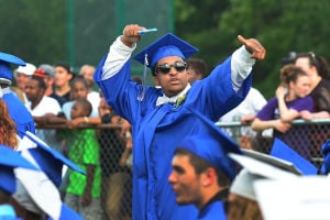 OAKCREST GRADUATION: Graduate Chris Williams of Mays Landing waves to family after receiving his diploma. Monday June 17 2013 Oakcrest High School Graduation. Mays Landing. (The Press of Atlantic City / Ben Fogletto)  - Photo by Ben Fogletto