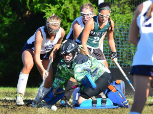 Mainl Field Hoc: Mainland goalie Natalie Geary makes a save in traffic during the first period. Monday September 23 2013 Mainland at Atlantic City girls Field Hockey. (The Press of Atlantic City / Ben Fogletto) - Ben Fogletto