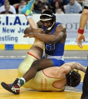 David Williams Takes 2nd In State At 182 Lbs.: Hammonton High School's David Williams, top, battles with Bergen Catholic's Johnny Sebastian for the state championship at 182 pounds Sunday in Atlantic City. Sebastian won, 4-3.