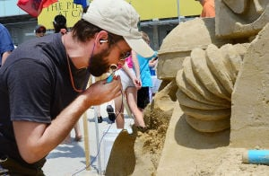 SAND SCULPTING: Sculptor Brian Turnbough of Joliet, Illinois works on his entry. Sunday June 16 2013 World Championship of Sand Sculpting on the beach next to the Pier at Caesars in Atlantic City. (The Press of Atlantic City / Ben Fogletto)  - Ben Fogletto