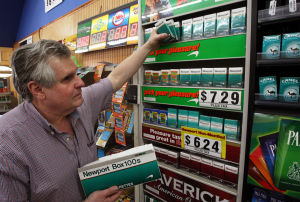 : Warren Hoff, of Vineland, owner of McLaughlin's News Agency on Landis Ave in Vineland, stocks his counter with cigarettes. Twenty five percent of the adult population of Cumberland County smokes, ranking it the highest in the state. Friday March 22, 2013, (Dale Gerhard/The Press of Atlantic City)  - Dale Gerhard