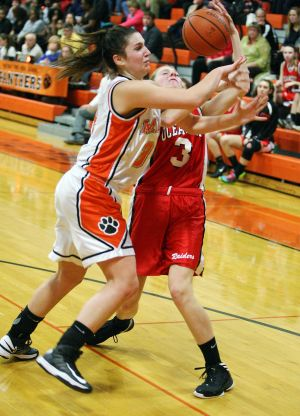 Middle Twp-oc Girls Basketball: Middle Township's Olivia Schwartz #34, left battle for the ball against Ocean City's Taylor Price #3 , right during basketball game at Middle Township High School Tuesday, Feb 5, 2013.  - Edward Lea