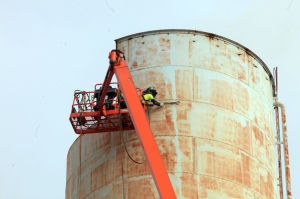 OC WATER TOWER: New Jersey American Water began the process of disassembling the 125-foot landmark water tower at 11th and West Avenues in Ocean City, Thursday May 9, 2013  - Vernon Ogrodnek