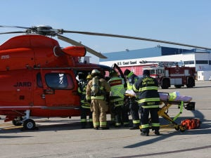 AIRPORT DISASTER DRILL: Firefighters arrive to assess the scene. - Photo by Michael Ein