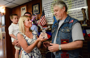 KAUFFMAN: Kauffman's daughter, Kimberly Pack presents the award to Micheal Merlino. Saturday July 13 2013 The April Kauffman Award honoring a veterans advocate, is presented to Michael Merlino of EHT at the Somers Point American Legion Post 352. (The Press of Atlantic City / Ben Fogletto) - Ben Fogletto