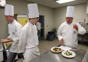 : Culinary instructor Jon Davies of West Cape May, (right) grades the dishes prepared by Jacob Lance of West Cape May. The Cape campus of Atlantic Cape Community College in Cape May Court House, now offers a Culinary Arts Training Program. Wednesday April 3, 2013. (Dale Gerhard/The Press of Atlantic City)  - Dale Gerhard