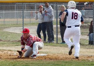 Vineland Vs. Millville Baseball: Vineland's Andrew Gee #15 makes the out against Millville's Nick Grotti #18 during second inning of the baseball game at Millville High School Wednesday, April 2, 2014. - Edward Lea