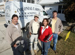 Restoration 4: Jim Quirk, left, son Kyle, wife Lisa and brother Tom own and run Colonial Carpet Cleaning and Restoration.  - Dale Gerhard