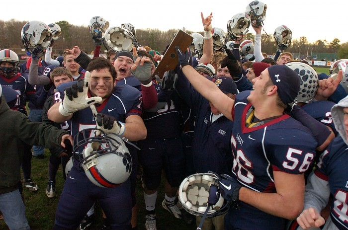 Lacey football players celebrate after beating Delsea