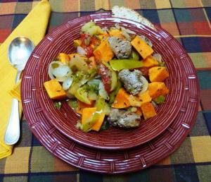 Apples sweeten quick stew made with sausage, sweet potato