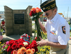 : A. Gary Oberholtzer of VFW Post 5941 North Wildwood, takes roses to hand out during the ceremony. Memorial Day services held at Veterans Memorial on Spruce and New Jersey Avenues in North Wildwood. Monday May 27, 2013. (Dale Gerhard/The Press of Atlantic City)  - Dale Gerhard