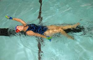 Surf City's Klose  keeps in the swim training in pool and weight room