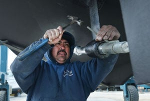 Boating Rebound: Sergio Fernandez of Somers Point works on a propeller shaft while preparing a boat for the water at C-Jam Yachts in Somers Point. Tuesday April 2 2013 (The Press of Atlantic City / Ben Fogletto)  - Ben Fogletto