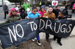 "RISE UP MARCH: South Main Street School first-graders Jamaya Mathieu, 6, left, Chanelle Temple, 7, Pablo Figueroa, 7, and Leonardo Ventura, 8, march with a ""Say No to Drugs"" banner Wednesday, Feb. 19, 2014, as part of a Rise Up March, symbolizing unity over ending violence, drugs and crime in their hometown of Pleasantville. - Michael Ein"