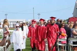 OCHS Graduation: Graduates march into the recreation field for their Graduation Commencement form Ocean City High School Friday, June 20, 2014. - Edward Lea