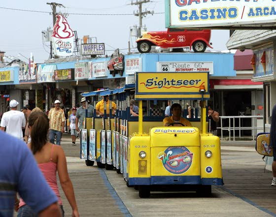 'Watch the tram car, please'Yellow cars on Wildwood Boardwalk are a familiar sight to weary tourists