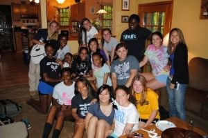 My Life: EHT Senior Lola Agabalogun: Lola, standing on the far right in the back row, gathers with friends at a 2011 EHT team dinner.
