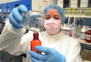 Compound: Jersey Shore Pharmacy manager, Rossana Belfiore, of Absecon, fills a prescription bottle Jan. 24 with solution in the lab of the pharmacy. The Jersey Shore Pharmacy, in Egg Harbor Township, specializes in preparing compounds for patients.The state is considering beefing up regulations over compounding pharmacies after contaminated medicine from a compounding pharmacy in Massachusetts killed dozens of people and sickened hundreds more.  - Photo by Danny Drake