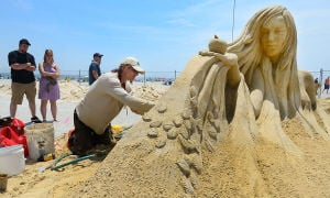 SAND SCULPTING: Sculptor Karlis Ile of Latvia works on his entry. Sunday June 16 2013 World Championship of Sand Sculpting on the beach next to the Pier at Caesars in Atlantic City. (The Press of Atlantic City / Ben Fogletto)  - Photo by Ben Fogletto