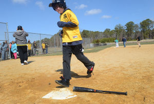 Challenger League Softball: John Heidenthal, 13, of Manahawkin crosses home plate. Sunday April 7 2013 Special-needs students from Southern Regional and Pinelands Regional play in an Ocean/Monmouth County High School Challenger League softball game. (The Press of Atlantic City / Ben Fogletto)  - Photo by Ben Fogletto