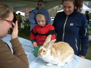 Cape May County Earth Day 1: Malaga resident Anne Dinshah and her son Clint, 2, pet a 10-pound rabbit Saturday at the Cape May County Earth Day Celebration at the Cape May County Park & Zoo. The rabbit was raised by Kristin Hughes, 15, of Middle Township, a member of the Cape May County 4-H.  - Brian Ianieri