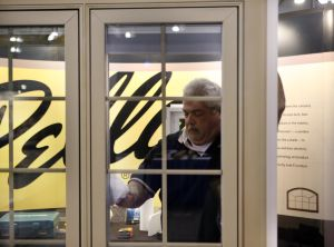 Builders: Steven Valvano, of Pella Windows and Doors of West Caldwell, Essex County, sets up the display for the Atlantic Builders Convention at the Atlantic City Convention Center that started Tuesday. More than 6,000 builders from across New Jersey are expected to attend. - Edward Lea