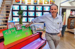 Peter Max: American painter Peter Max poses in his New York Studio. He will present an exclusive exhibit at Ocean Galleries Stone Harbor this Labor Day weekend. - Photo by Michael Ein